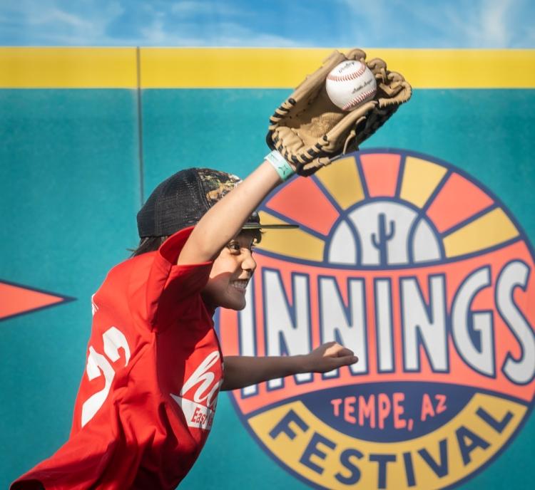 Innings festival baseball activities 2020 kid catching baseball